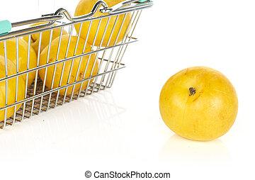 Fresh yellow plum isolated on white