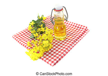 fresh yellow Rapeseed oil on a light background