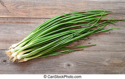 Fresh young onion on wooden table