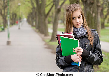 Fresh young student girl in the park.
