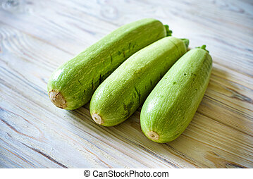 Fresh zucchini on wooden background. Top view.
