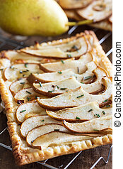 Freshly backed Puff pastry Pear tart with goat cheese,...