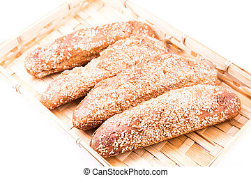 Freshly baked bread rolls with sesame