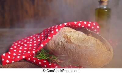 Freshly baked bread wrapped in a towel.