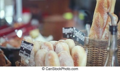 Freshly baked breads baguettes, rolls for sale in wicker...