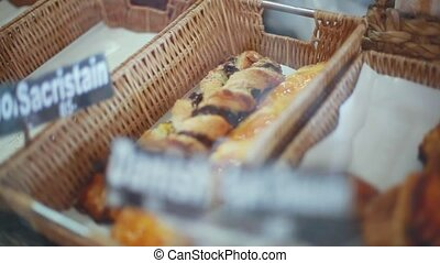 Freshly baked breads baguettes, rolls for sale in a bakery....