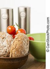 Freshly baked brown wholegrain bread rolls
