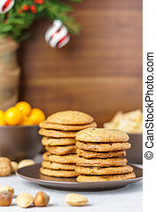 freshly baked chocolate chip cookies on a table with blurred background.