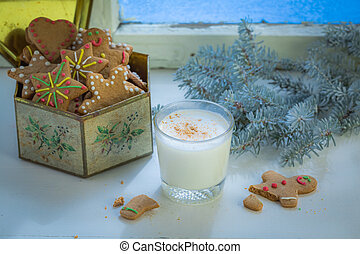 Freshly baked cookies with milk for Christmas in cold evening