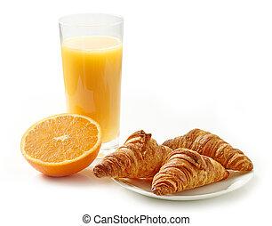 freshly baked croissants and orange juice