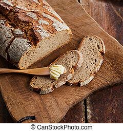 Freshly baked crusty loaf of rye bread