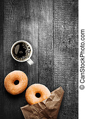 Freshly baked doughnuts with filter coffee