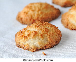 Freshly baked home made coconut macaroons or pyramids, shallow depth of field