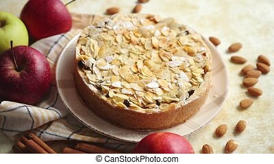 Freshly baked homemade apple pie with almond flakes cake on...