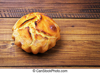 Freshly baked homemade bread on dark wood background
