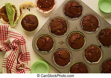 Freshly baked homemade chocolate cup cakes on white table