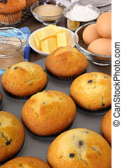 Freshly baked muffins with ingredients