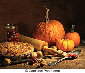 Freshly baked pie with pumpkin , nuts and cranberries on...