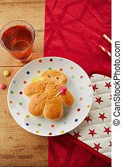 Freshly baked Stuten bread man on a festive red themed table...