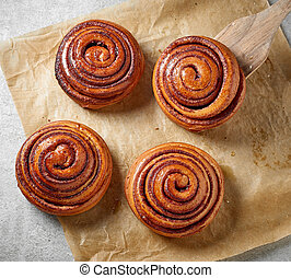 freshly baked sweet cinnamon buns on kitchen table, top view