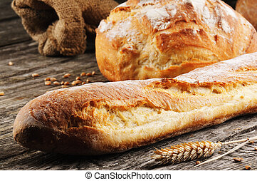 Freshly baked traditional French bread on wooden table
