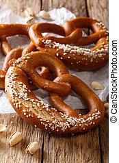 Freshly baked traditional pretzel with salt close-up. Vertical