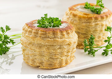 Freshly baked vol-au-vents with mushroom filling, topped...