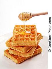 freshly baked waffles with honey