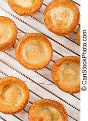 freshly baked yorkshire pudding on a cooling rack
