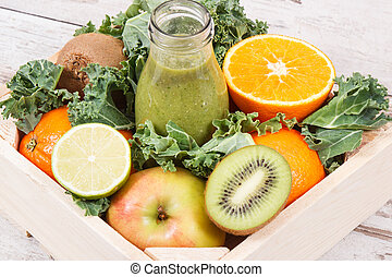 Freshly blended green coctail from fruits and vegetables. Concept of diet and healthy nutrition