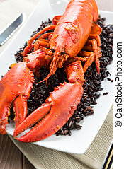 Freshly caught Lobster with black rice in dish