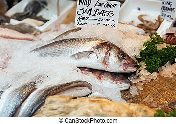 Freshly caught Sea Bass fishes and other seafood on display...