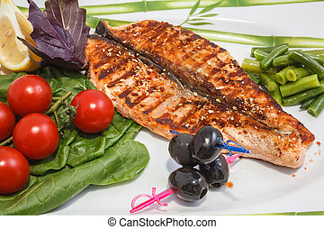 freshly cooked fish and fresh vegetables on the plate