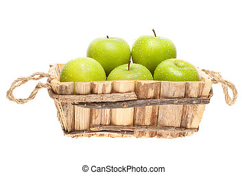 """freshly harvested """"Granny Smith"""" apples in a wooden basket"""
