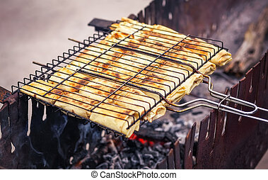 Freshly pancakes with filling, roasted on the grill.