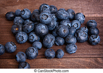 Freshly picked blueberries on a wooden background