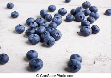 Freshly picked blueberries on white table