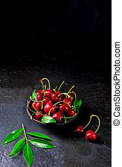 freshly picked cherry in a wooden bowl