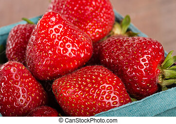 Freshly picked strawberries in a basket - Freshly picked...