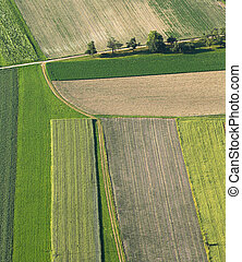 Freshly plowed and sowed farming land from above, neatly ...