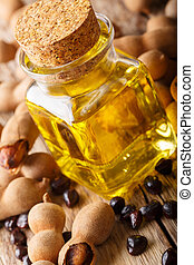 Freshly prepared tamarind seed oil in a glass jar close-up...
