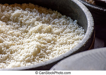 Freshly prepared white rice on a clay pot