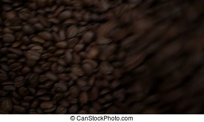 Freshly roasted coffee beans falling into a spinning cooler...