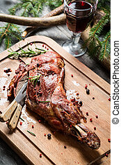 Freshly roasted venison with rosemary and pepper