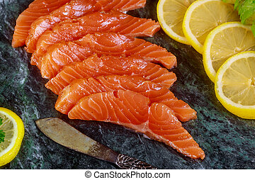 Freshly salmon with lime, avocado on a marble plate horizontal