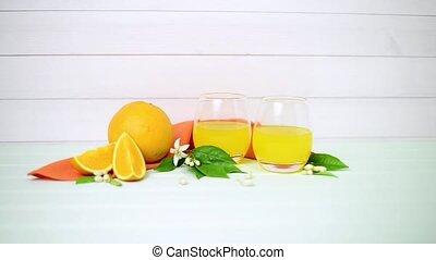Freshly squeezed orange juice on wood background