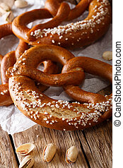 Freshly traditional pretzels with salt close up on the paper. vertical
