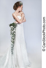 Freshness - attractive bride blonde, fresh colorful flowers