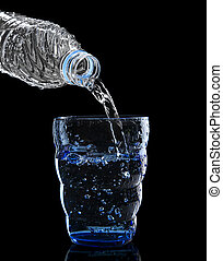 freshness cool and clean drinking water pouring to blue glass isolated on black background use for healthy care food and drink beverage