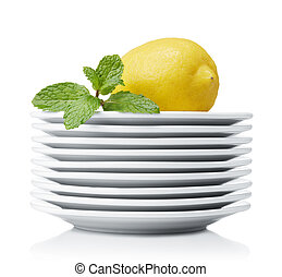 freshness - lemon with mint leaves on stack of plates